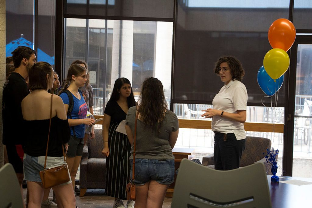 Alex Gallin-Parisi with students in the Library