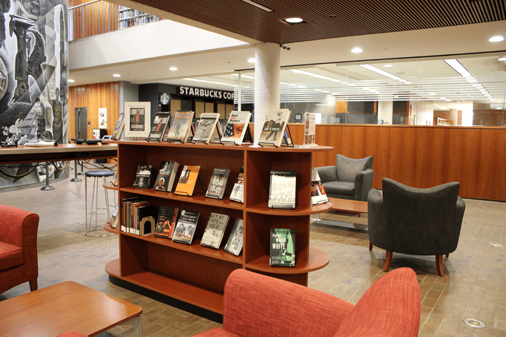Library lobby with book display and Starbucks in the background